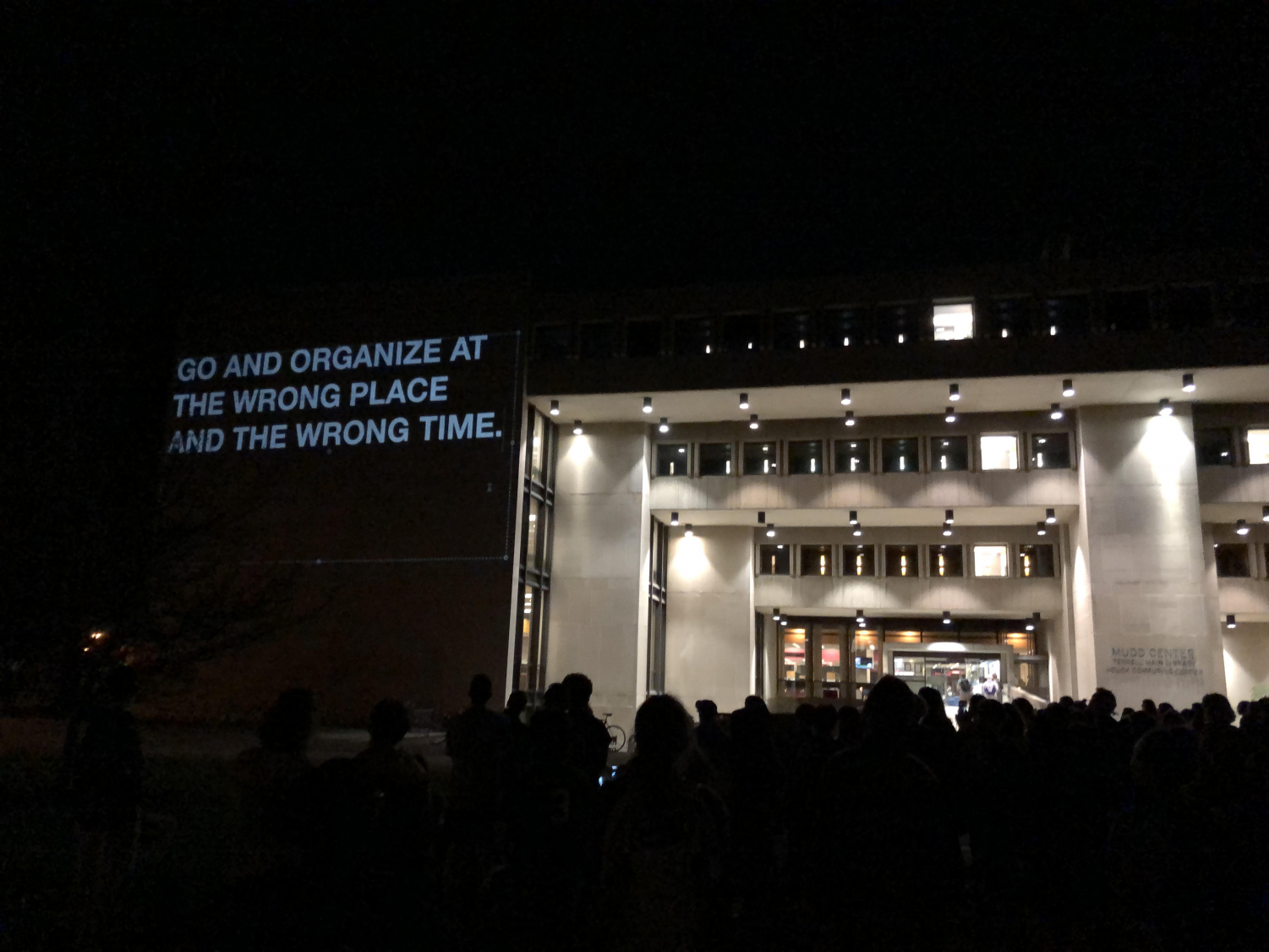 A visual history of Oberlin activism was projected onto the outside of Mudd Center last Thursday.