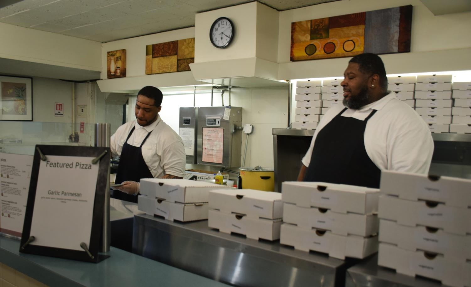 CDS workers prepare pizzas in the Wilder DeCafé. Hourly employees continue to express concerns over the impacts of the AAPR recommendations.