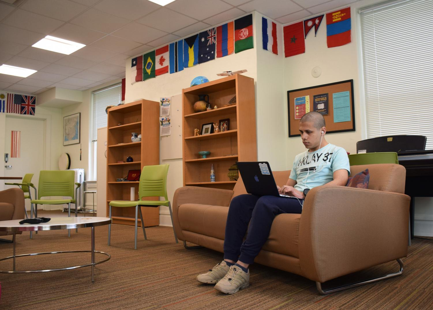 College first-year Marwan Ghanem works on his laptop in the International Student Resource Center.