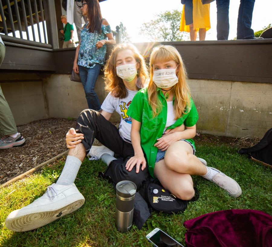 College students write important messages on face masks to emphasize the importance of preventing further damage to the environment.