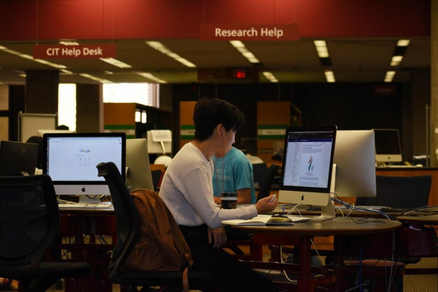 A student uses a computer in Mary Church Terrell Main Library. A new password service, Okta, will impact the way students log into their Oberlin accounts.