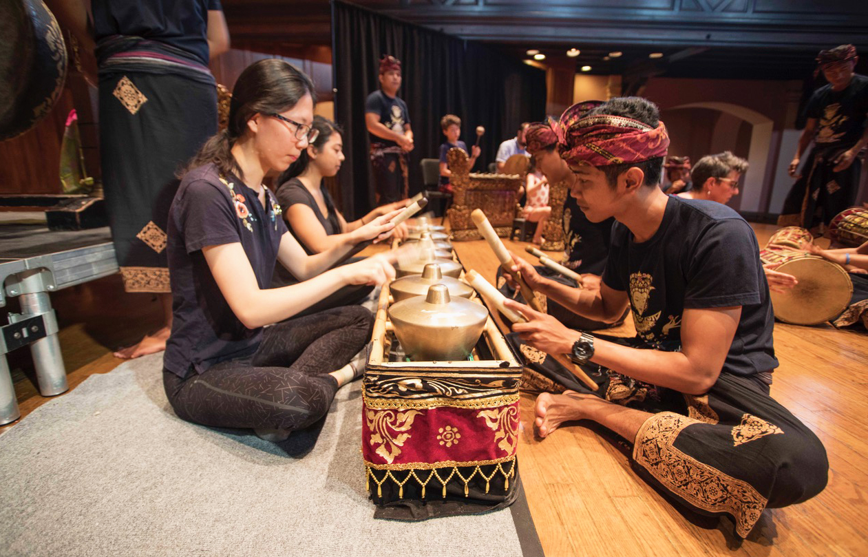 """One of the most respected Balinese performing companies, Çudamani, came to Oberlin to perform in Finney Chapel last Tuesday. The 18-member company is internationally recognized, and their Oberlin performance was part of their world tour. The group name Çudamani means """"to do something with your whole heart without expecting something in return,"""" according to the group's website. Watching their performance, it's easy to see this goal come to life through their passion. The performance integrated costumes, dancing, vocal performances, and Gamelan, which is music played using traditional Indonesian instruments. Each of their performances had a specific theme. """"Teruna Gandrung"""" showcases a tradition of challenging gender norms, featuring women in energetic, fearless, and powerful roles. Another piece called """"Ramayana Wayang Wong"""" featured two people dressed in red and yellow, wearing masks. The story followed twin brothers who jumped into a pool of water while fighting over a chalice. After they fell into the water, they turned into monkeys. There were also sections in which dancers improvised their movements and signaled to the percussionists to change the tempo and melody. In order to communicate while on stage, performers made eye contact with each other and smiled. """"We are told to put ourselves into the story but not just technical movements, so we don't practice with mirrors, because my teacher said that it is better to feel your partner than watch them in the mirror,"""" said Dewa Ayu Eka Putri, one of the dancers and the group's secretary. In addition to performing, Çudamani holds workshops wherever they tour including at Oberlin this past week. """"Çudamani told not only traditional dramas but also shared stories about their community and philosophy of collective care,"""" College fourth-year Kara Nepomuceno, a Dance major studying Southeast Asian dance, wrote in an email to the Review. """"In [the] workshop held on Wednesday morning, Associate Director Emiko Saraswati Susil"""