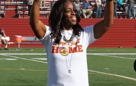 President Carmen Twillie Ambar on the field at halftime of the Homecoming football game.