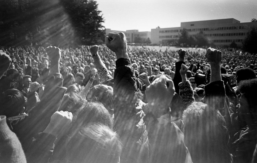 "Protesters raise their fists during ""Bloody Tuesday"" protests at San Francisco State College. The San Francisco Express Times ran this image on the front page of its December 4, 1968 issue."