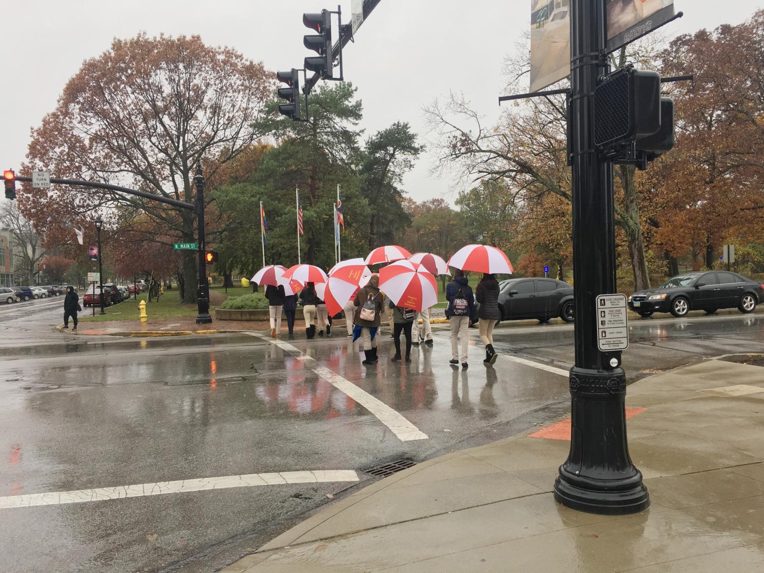 A tour guide leads a group on a campus tour. Demographic factors are impacting admissions strategies at colleges and universities across the country.