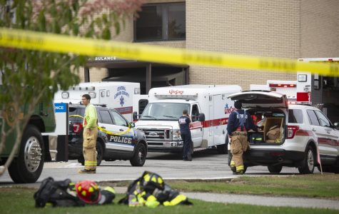 Emergency responders stand outside of Mercy Allen Hospital on Tuesday after seven people were exposed to an unknown substance.