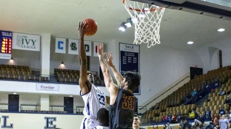 College third-year Jordan Armstrong defends the basket.