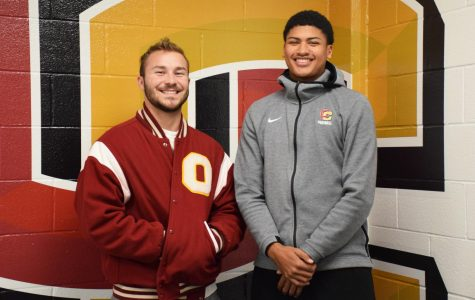 College fourth-year Zach Taylor stands beside College first-year Chris Allen Jr.