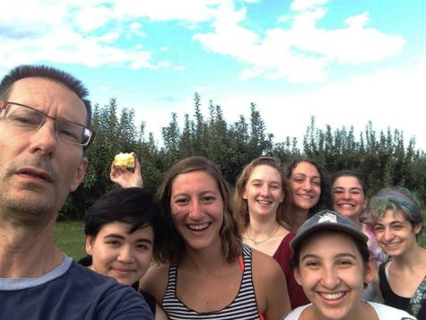 "Nathan A. Greenberg Professor of Classics and Acting Chair of Comparative Literature Kirk Ormand and former students in his ""Odysseys and Identities"" first-year seminar class on an apple-picking trip."