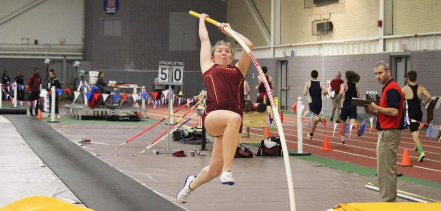 College+fourth-year+Grace+Finney+takes+a+final+step+before+launching+herself+into+the+air.%0APhoto+courtesy+of+OC+Athletics