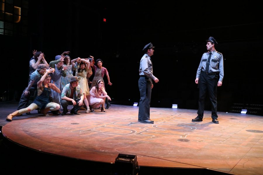 Urinetown's ensemble cast rehearsing for its opening night, which took place Thursday.