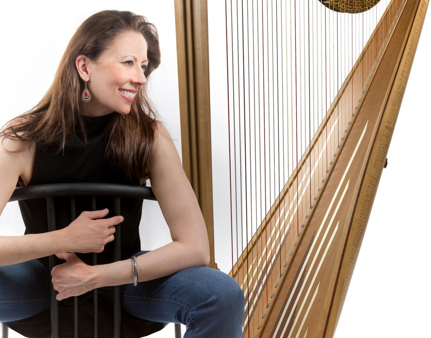 """Last week, Assistant Professor of Harp Yolanda Kondonassis was nominated for a Grammy Award in the Best Classical Instrumental Solo category for her world premiere recording of Jennifer Higdon's """"Harp Concerto."""" Kondonassis — no stranger to accolades — is considered one of the best solo harpists in the world. This is her second Grammy nomination, and she was also awarded the 2011 Cleveland Arts Prize. In addition to her work in music, Kondonassis is also a driven climate activist. She has donated her royalties from several projects to environmental nonprofit organizations, and she is the founder and director of Earth at Heart, an organization that encourages climate activism through an artistic lens. She also authored an environmentalist children's book, Our House is Round: A Kid's Book About Why Protecting Our Earth Matters. Kondonassis' music career started when she picked her instrument as a child. """"I started playing the harp at the age of nine, and it was actually my mom's idea,"""" Kondonassis wrote in an email to the Review. """"I think she thought the angelic qualities of the instrument would rub off on me! I've often said that instead of me becoming more angelic with the harp, I'm afraid that my forty-five years of promoting this instrument have probably made the harp a little less angelic as a result of me."""" Despite Kondonassis' humility, her many talents have made a mark on music history and the environment alike."""