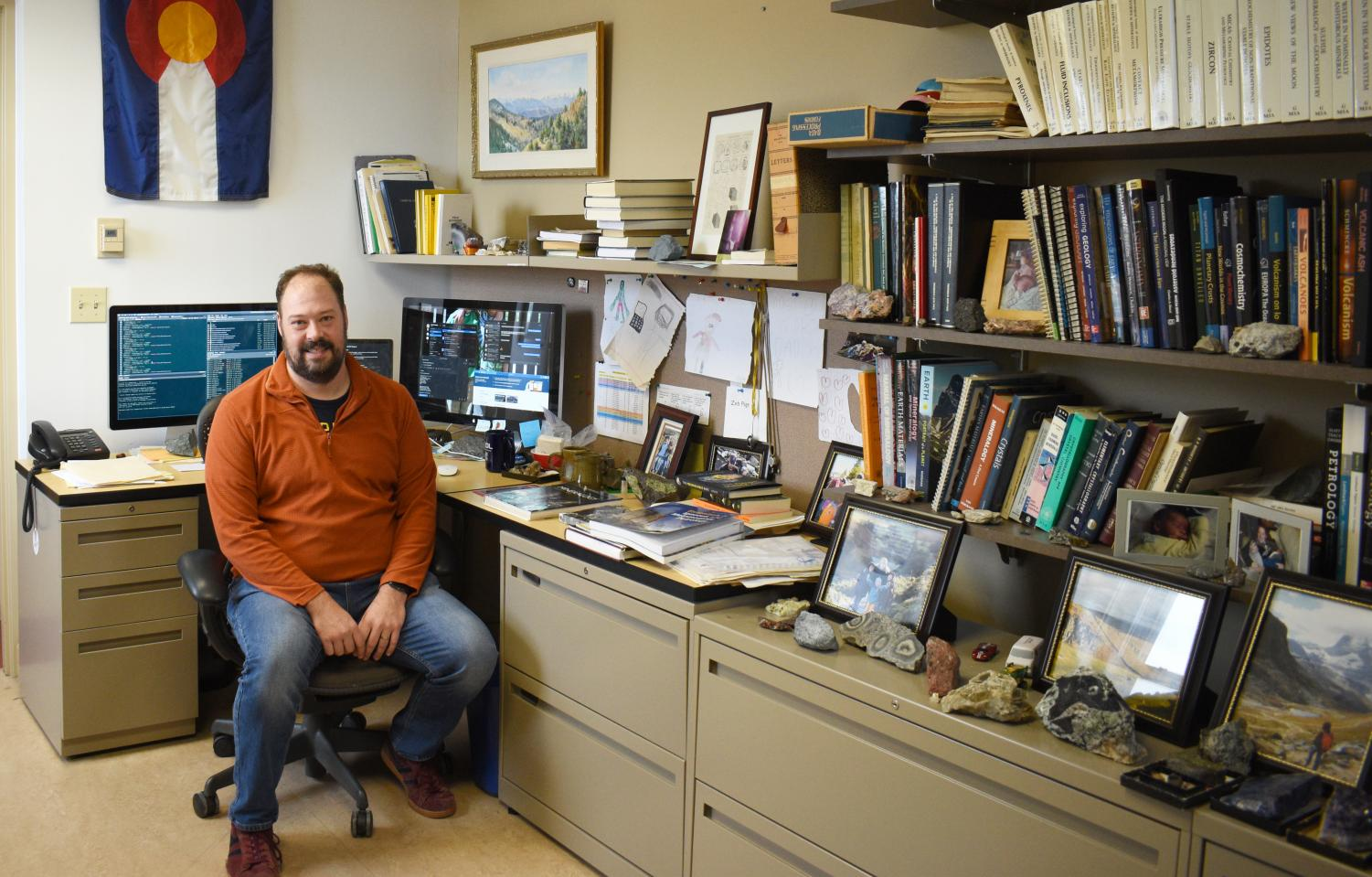 Associate Professor and Chair of Geology Zeb Page in his office. Page wrote a program to reconcile local student voting engagement numbers against data from the National Study of Learning, Voting, and Engagement.