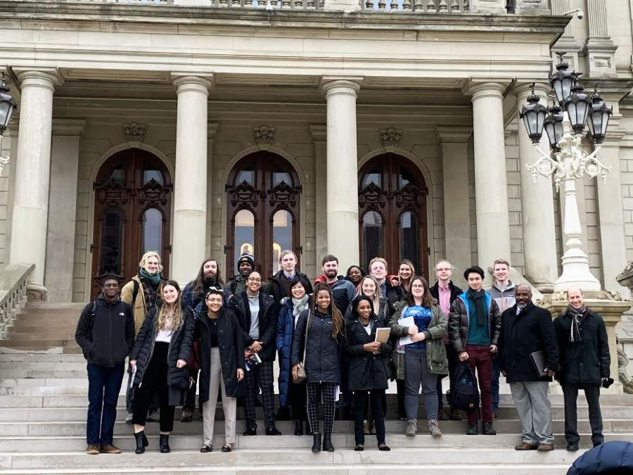 "Oberlin College and Spring Arbor University participants of the ""Bridging the Gap"" Winter Term project in front of the state Capitol in Lansing, MI before they met with elected officials to discuss prison reform."