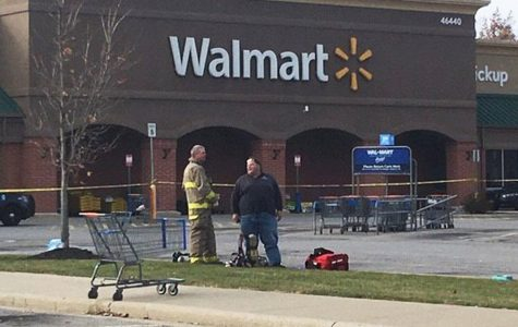 First responders stand outside of Walmart in October following the hospitalization of six people.