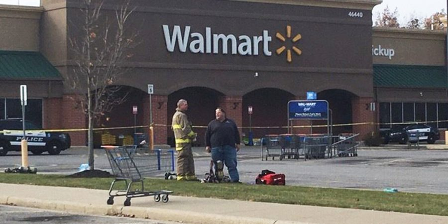 First+responders+stand+outside+of+Walmart+in+October+following+the+hospitalization+of+six+people.