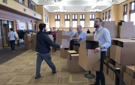 Faculty and staff distributed packing boxes to students in the Root Room in Carnegie Building beginning Friday morning. Students in College housing are required to vacate campus by Monday at noon. Box distribution will continue 9 a.m. – 4 p.m. on both Saturday and Sunday.