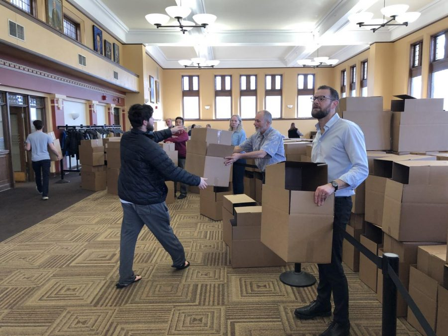 Faculty and staff distributed packing boxes to students in the Root Room in Carnegie Building beginning March 13. Students in College housing were required to vacate campus by Monday, March 16 at noon.