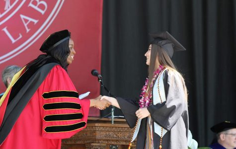 President Carmen Twillie Ambar shakes a graduate's hand at Oberlin's 2019 commencement ceremony. Photo by Amber Benford and courtesy of the Office of Communications.