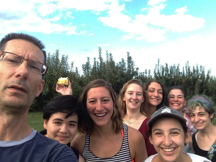"""Nathan A. Greenberg Professor of Classics and Acting Chair of Comparative Literature Kirk Ormand and former students in his """"Odysseys and Identities"""" first-year seminar class on an apple-picking trip."""