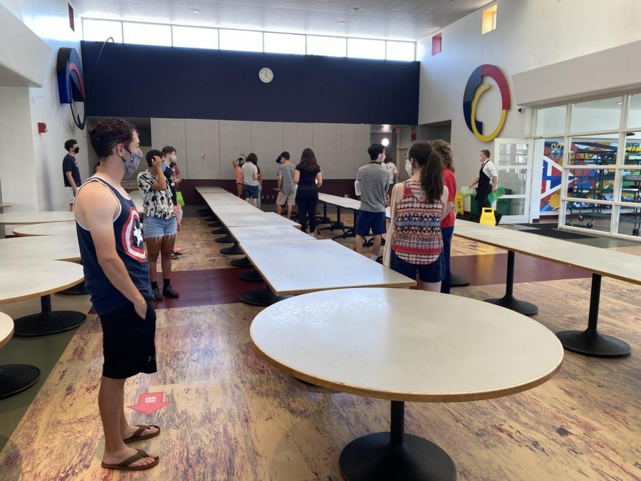College students stand in a socially-distanced line to enter Stevenson Dining Hall. Scheduled visits to a dining hall are the only time students are permitted to leave their dorm room until they receive a negative COVID-19 test result.