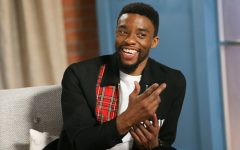 Chadwick Boseman smiles during an interview.