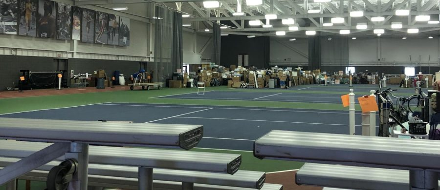 Piles of students' belongings in the Heisman Club Field House. Students can schedule an appointment to visit the field house and retrieve the belongings they left behind in March.