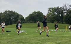The women's soccer team performs drills during one of its first socially distanced practices. Anisa Curry Vietze