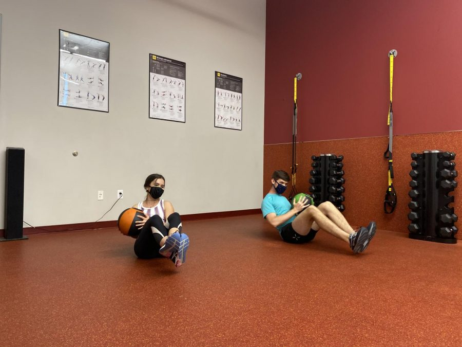 College students are required to wear masks while working out in Philips gym.