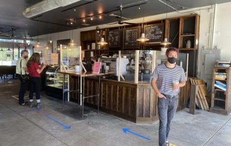 Patrons order coffee at Slow Train Cafe, which is currently open for socially-distanced walk-through service.