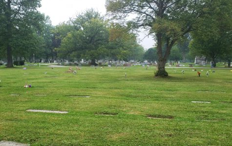 Flat gravestones are sinking into the ground in Section S of Westwood Cemetery.