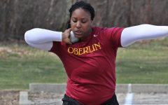 Monique Newton getting ready to launch shot put.