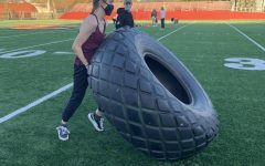 College fourth-year Katherine MacPhail flips out for tire flipping.