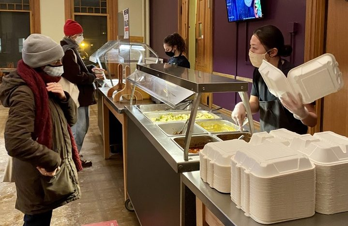 A student picks up dinner at Heritage, the kosher dining hall located in Talcott Hall. The space was previously occupied by the Kosher and Halal co-op.
