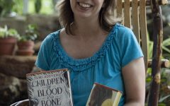 April Mather, visiting professor of Environmental Studies, holds up some of her favorite books.