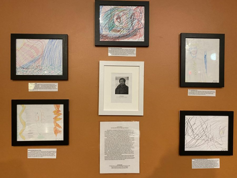 Keagan Tan's fake art installation featured five crayon drawings with corresponding captions and a fictional artist biography accompanying a random internet portrait photo.