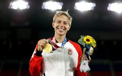 Canadian soccer player Quinn winning a gold medal at Tokyo 2020 Olympic Games.