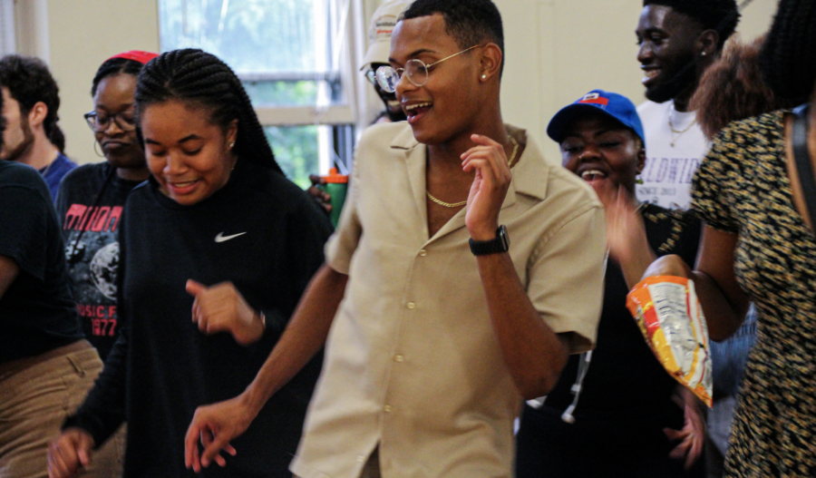 Photo by Rachel Serna-Brown. Students do a line dance at the Juneteenth Block Party.