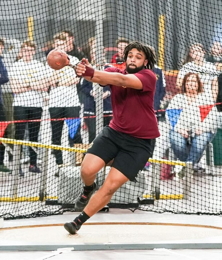 College third-year and thrower on the track and field team Zac Ntia.