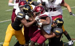 Homecoming: Oberlin football competing against The College of Wooster in 2019.