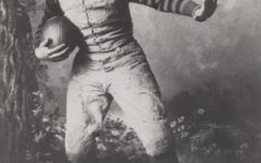 John Heisman poses in his iconic stance back in the day.