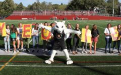 Yeobie stands before the crowd on Bailey Field celebrating with students at Homecoming in 2019.